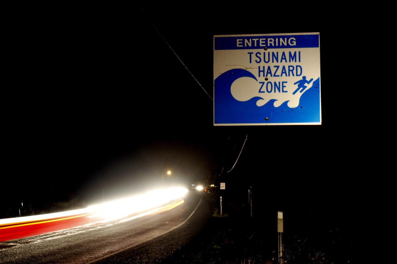 FILE--In this March 11, 2011, file photo, car headlights form a steady stream of cars as residents evacuate the coastal town of Seaside, Ore., after tsunami warnings were issued as a result of an earthquake in Japan. The big earthquake off the coast of Alaska triggered a tsunami watch for the Oregon Coast during the predawn hours Tuesday,Jan. 23, 2018, and while no tidal wave materialized, officials said it is a wake-up call. (AP Photo/Don Ryan, file)