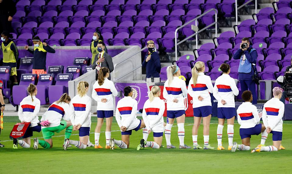 Several United States players take a knee during the national anthem before their match against Colombia in January.