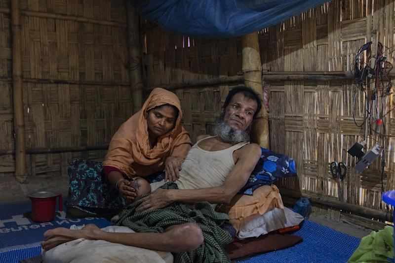 Inan Hossein, with his wife Halema Khatun, lost his leg to a gunshot from a government soldier in Myanmar. | James Nachtwey for TIME