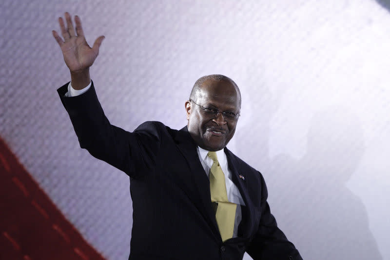Former Republican presidential candidate Herman Cain waves as he take the stage to address the Faith & Freedom Coalition Road to Majority Conference in Washington