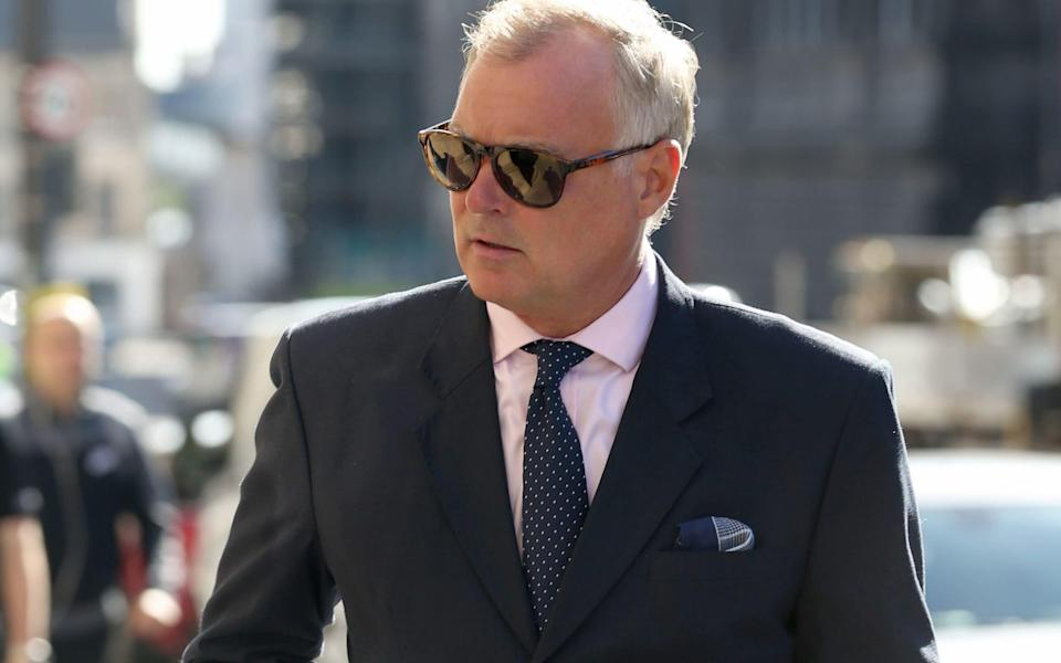 John Leslie has denied grabbing a woman's breasts at a Christmas party in 2008