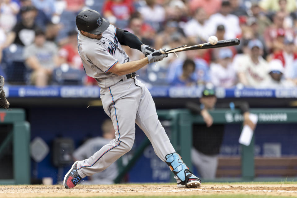 Miami Marlins' Adam Duvall breaks his bat on a single during the fourth inning of a baseball game against the Philadelphia Phillies, Sunday, July 18, 2021, in Philadelphia. (AP Photo/Laurence Kesterson)