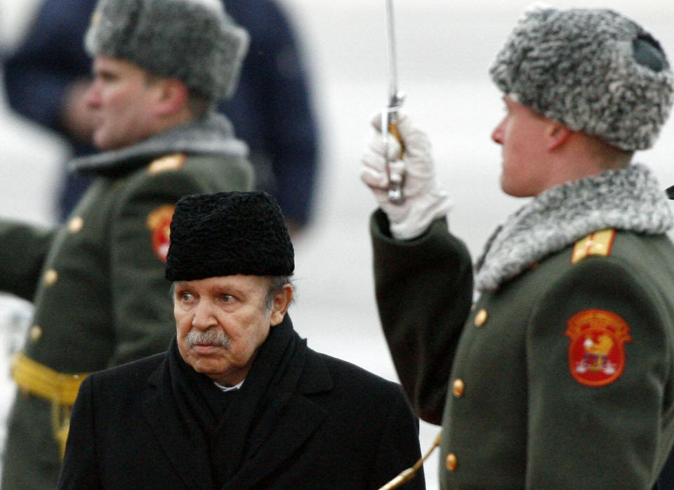 FILE - In this Monday, Feb. 18, 2008, file photo Algeria's President Abdelaziz Bouteflika attends an official welcome ceremony on his arrival to Moscow. Former Algerian President Bouteflika, who fought for independence from France in the 1950s and 1960s and was ousted amid pro-democracy protests in 2019 after 20 years in power, has died at age 84, state television announced Friday, Sept. 17, 2021. (AP Photo/Mikhail Metzel, File)