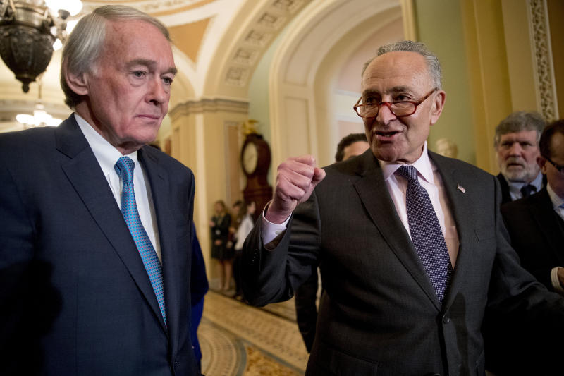 Senate Minority Leader Sen. Chuck Schumer of N.Y., right, accompanied by Sen. Ed Markey, D-Mass., left, speaks to members of the media following a Senate policy luncheon on Capitol Hill in Washington, Tuesday, March 26, 2019. (AP Photo/Andrew Harnik)