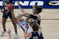 South Carolina forward Victaria Saxton, left, and Georgia Tech forward Lorela Cubaj, back right, battle for a rebound during the first half of a college basketball game in the Sweet Sixteen round of the women's NCAA tournament at the Alamodome in San Antonio, Sunday, March 28, 2021. (AP Photo/Eric Gay)