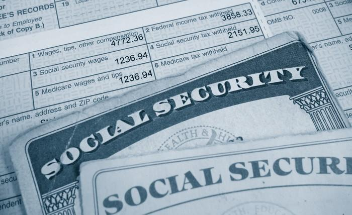 Social Security cards on top of a tax form