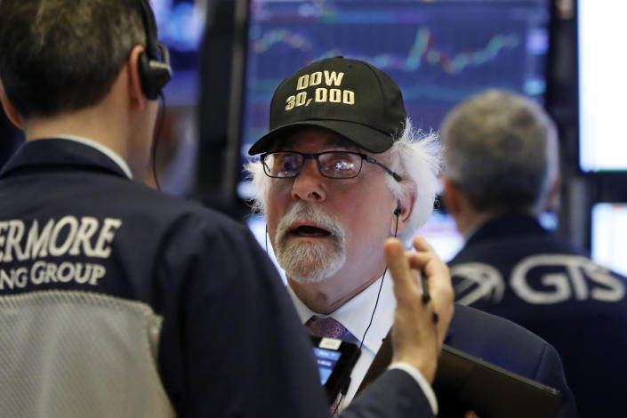 "Trader Peter Tuchman wears a ""Dow 30,000"" cap as he works on the floor of the New York Stock Exchange, Wednesday, March 4, 2020. The Dow Jones Industrial Average soared more than 1,100 points, or 4.5%, on hopes for more stimulus measures from around the globe to fight the virus outbreak. (AP Photo/Richard Drew)"