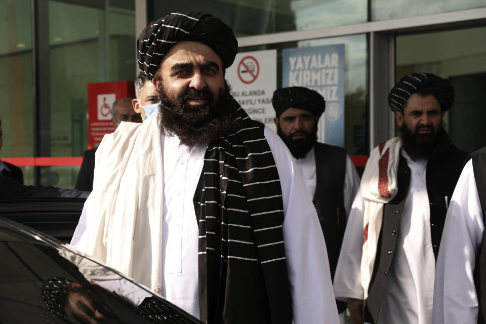 The Taliban delegation led by Amir Khan Muttaqi, the acting foreign minister, front, at Esenboga Airport, arrive in Ankara, Turkey, Thursday, Oct. 14, 2021. A high-level delegation of Afghanistan's new Taliban rulers has arrived in Turkey for talks with Turkish officials, the Foreign Ministry announced Thursday. The meetings in the capital of Ankara would be first between the Taliban and senior Turkish government officials after the group seized control of Afghanistan. (AP Photo/Burhan Ozbilici)
