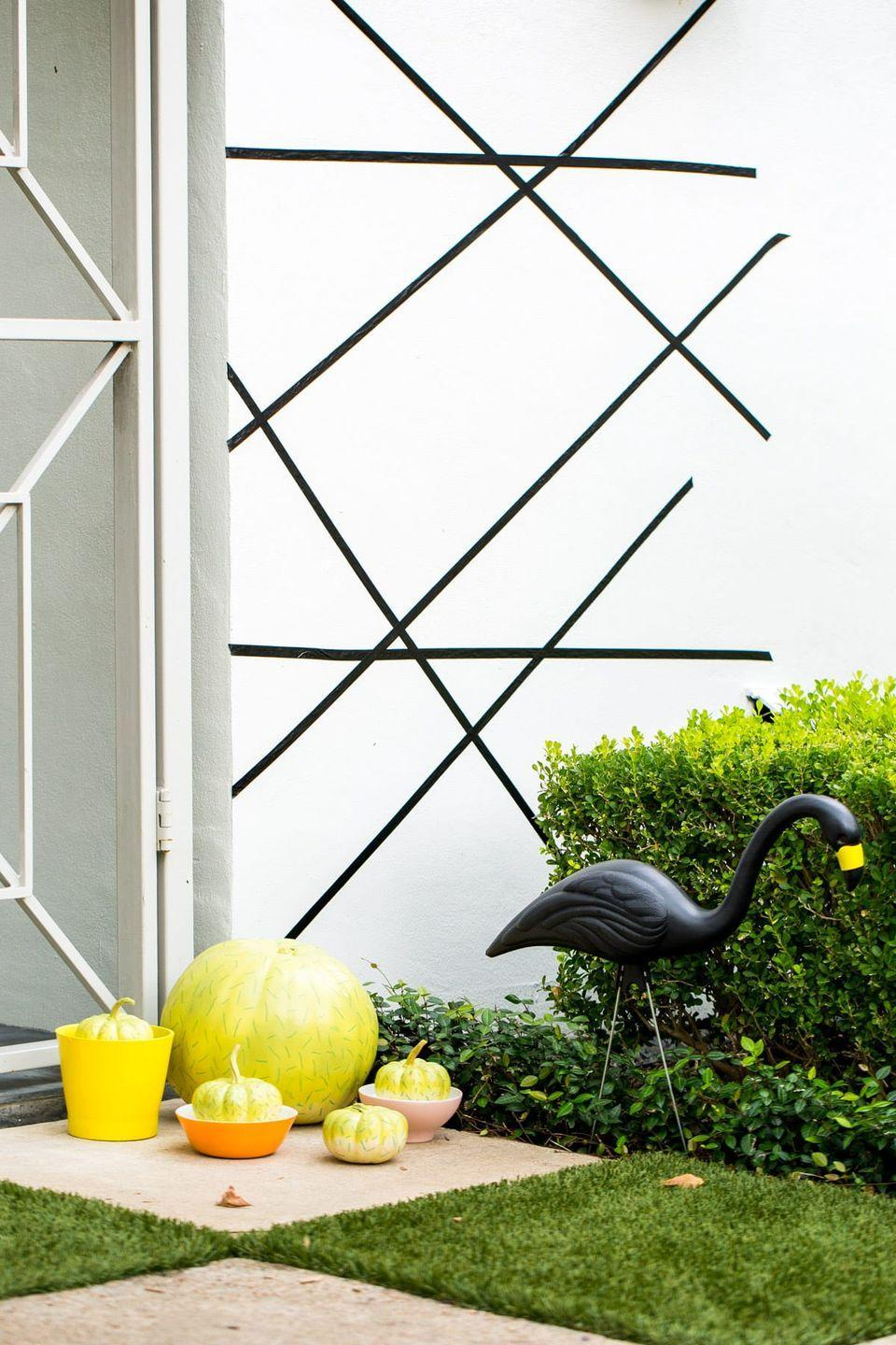 """<p>If your yard has more palm trees than maple trees, don't give up on decorating for Halloween. These plastic flamingos will blend in just fine, no matter the season.</p><p><a class=""""link rapid-noclick-resp"""" href=""""https://www.amazon.com/Pink-Inc-Halloween-Flamingos-Ornaments/dp/B000WM8W6K/?tag=syn-yahoo-20&ascsubtag=%5Bartid%7C10055.g.421%5Bsrc%7Cyahoo-us"""" rel=""""nofollow noopener"""" target=""""_blank"""" data-ylk=""""slk:SHOP BLACK FLAMINGOS"""">SHOP BLACK FLAMINGOS</a></p><p><em><a href=""""https://sugarandcloth.com/palm-springs-inspired-halloween-decor/"""" rel=""""nofollow noopener"""" target=""""_blank"""" data-ylk=""""slk:Get the tutorial at Sugar & Cloth »"""" class=""""link rapid-noclick-resp"""">Get the tutorial at Sugar & Cloth »</a></em> </p>"""