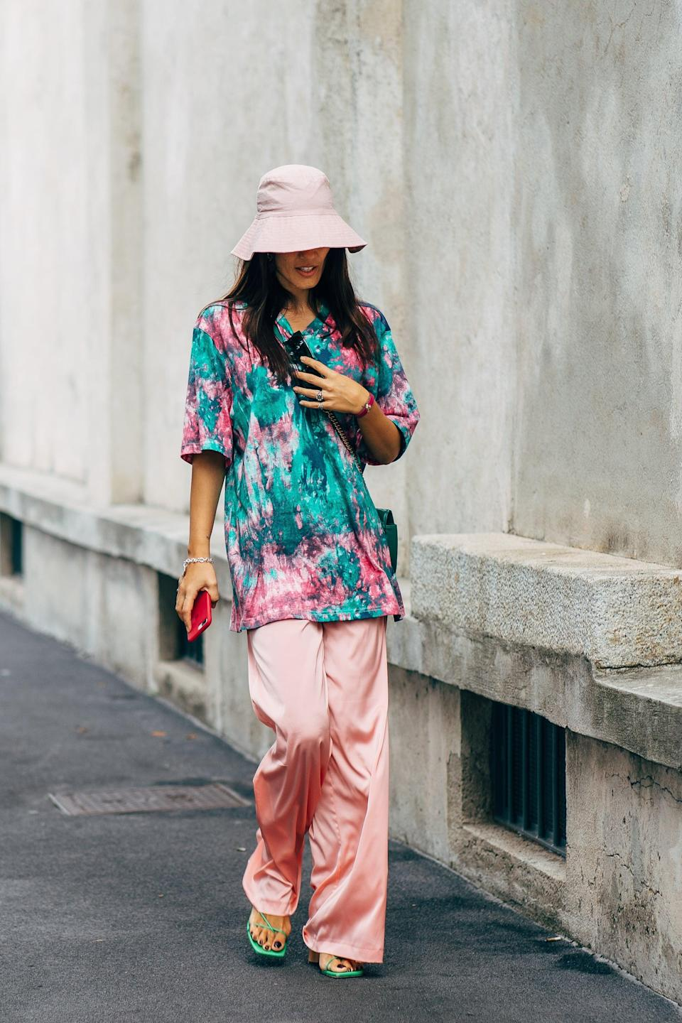 <p>Channel tourist-chic with a vacation-inspired button-down in a bold print, and pair it with a sunhat.</p>