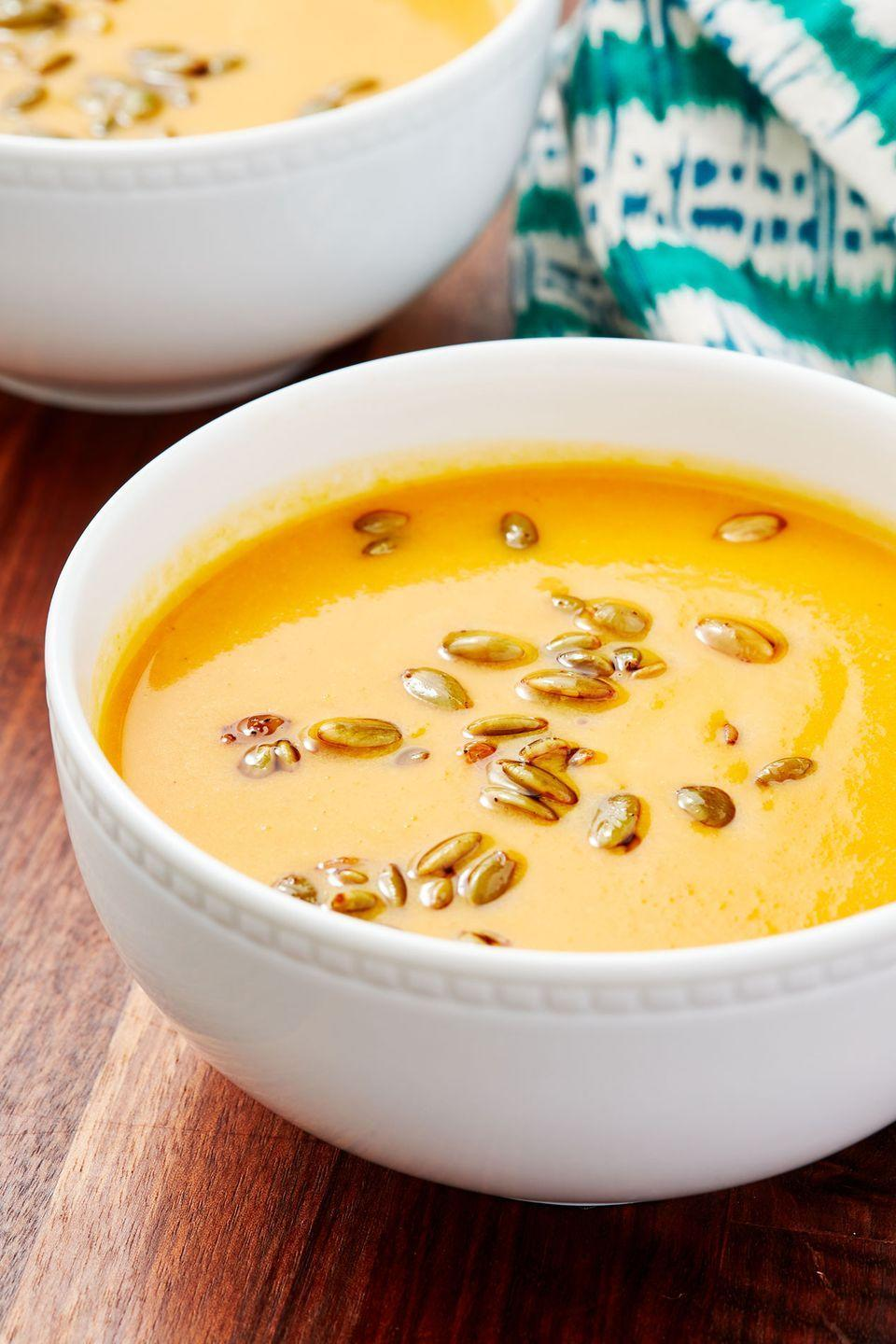 """<p>No need to restrict this to Autumn only—any rainy day calls for a comforting bowl of soup like this richly flavored, silky squash soup. The toasted pepitas are an amazing garnish! </p><p>Get the recipe from <a href=""""https://www.delish.com/cooking/recipe-ideas/a28835116/panera-autumn-squash-soup-recipe/"""" rel=""""nofollow noopener"""" target=""""_blank"""" data-ylk=""""slk:Delish"""" class=""""link rapid-noclick-resp"""">Delish</a>.</p>"""