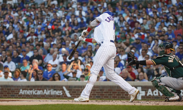 Chicago Cubs' Nicholas Castellanos hits a solo home run against the Oakland Athletics during the first inning of a baseball game, Monday, Aug. 5, 2019, in Chicago. (AP Photo/Kamil Krzaczynski)