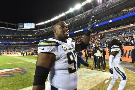 FILE PHOTO: Dec 30, 2018; Denver, CO, USA; Los Angeles Chargers nose tackle Brandon Mebane (92) celebrates the win over the Denver Broncos at Broncos Stadium at Mile High. Mandatory Credit: Ron Chenoy-USA TODAY Sports - 11920859