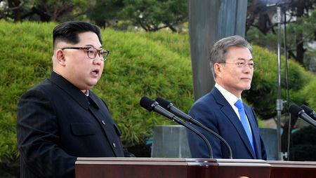 North Korean leader Kim Jong Un and South Korean President Moon Jae-in deliver a statement at the truce village of Panmunjom