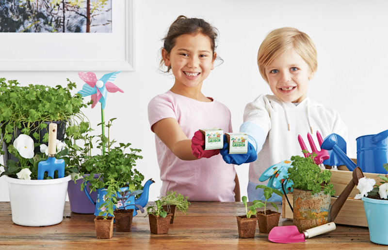 A Woolworths promotion photo showing children can learn how to plant seeds as part of the Discovery Garden supermarket collectables campaign.