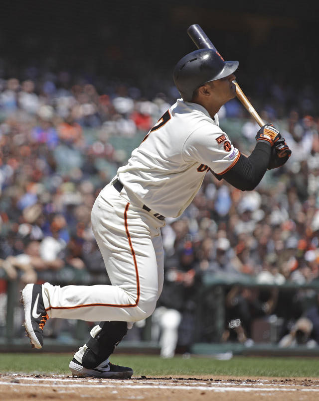 San Francisco Giants' Donovan Solano hits for an RBI sacrifice fly off Atlanta Braves' Kevin Gausman in the second inning of a baseball game Thursday, May 23, 2019, in San Francisco. (AP Photo/Ben Margot)