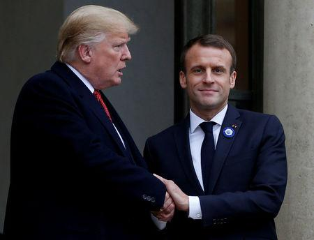 FILE PHOTO: French President Emmanuel Macron shakes hands with U.S. President Donald Trump after a meeting at the Elysee Palace in Paris