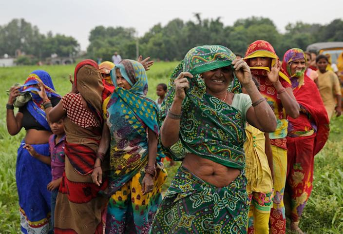 <p>Women look at the Indian Air Force helicopter as it lands with relief material in a field on the outskirts of Allahabad, India, Friday, Aug. 26, 2016. (AP Photo/Rajesh Kumar Singh)</p>