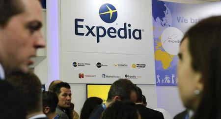 Visitors browse at the stand of global online travel brand Expedia during the International Tourism Trade Fair (ITB) in Berlin, Germany, March 9, 2016. REUTERS/Fabrizio Bensch/Files