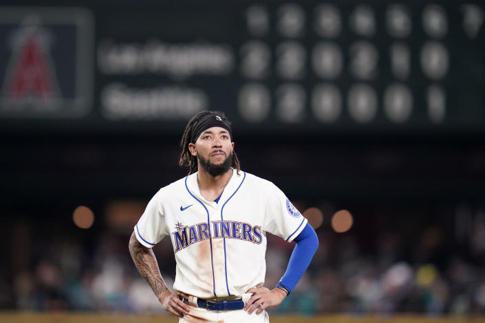 Seattle Mariners' J.P. Crawford stands on the field after being thrown out on a fielder's choice by the Los Angeles Angels to end the sixth inning of a baseball game Sunday, Oct. 3, 2021, in Seattle. (AP Photo/Elaine Thompson)