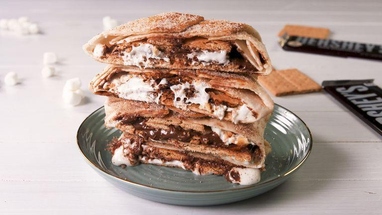 """<p>Sure you could just stick a marshmallow over a fire, or you can recreates this sweet version of the Taco Bell classic.</p><p>Get the recipe from <a href=""""https://www.delish.com/cooking/recipe-ideas/a21085533/smores-crunchwrap-recipe/"""" rel=""""nofollow noopener"""" target=""""_blank"""" data-ylk=""""slk:Delish"""" class=""""link rapid-noclick-resp"""">Delish</a>.</p>"""