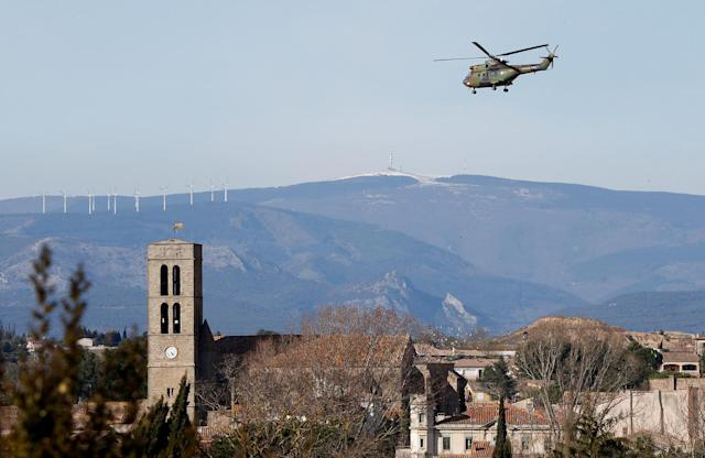 <p>A military helicopter flies over the village of Trebes after a hostage situation in a supermarket, France, March 23, 2018. (Photo: Jean-Paul Pelissier/Reuters) </p>