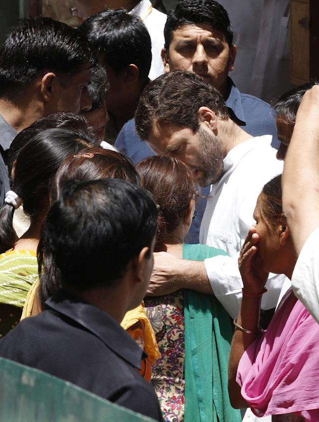NEW DELHI, INDIA - MAY 2: Congress Vice President Rahul Gandhi consoles family of Indian convict in Pakistan who died in Pakistan hospital after being attacked by fellow inmates on May 2, 2013 in New Delhi, India. Sarabjit was arrested in 1990 after bombings in Lahore and Faisalabad that killed 14 people and was convicted of spying and carrying out the bomb blasts. His family maintained Singh was innocent and had entered Pakistan inadvertently from his hometown of Bhikiwind in northern Punjab state bordering Pakistan. (Photo by Arvind Yadav/Hindustan Times via Getty Images)