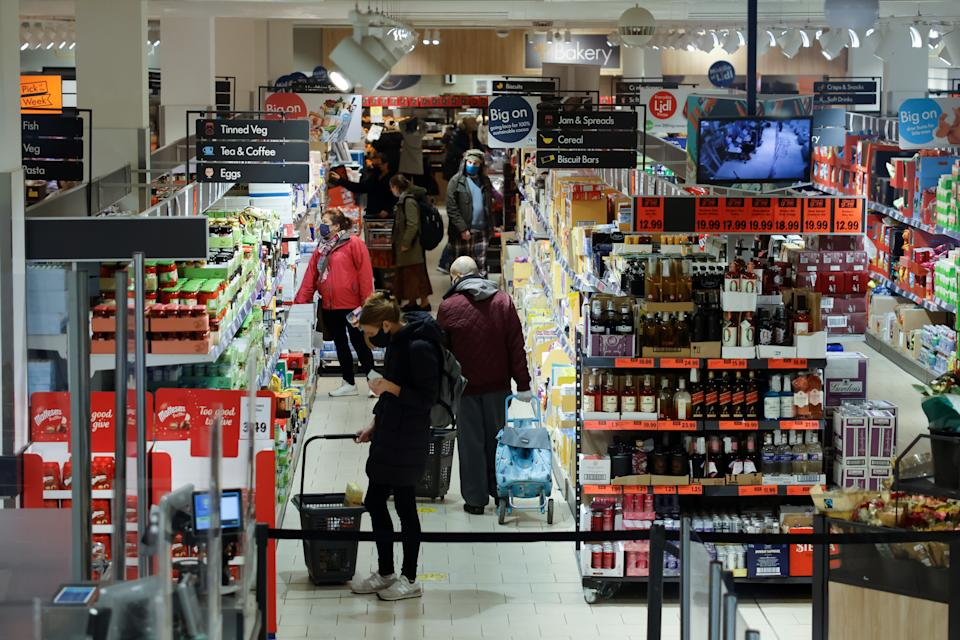 Shoppers browse for goods inside an Lidl supermarket in Walthamstow in north east London on December 22, 2020. - The British government said Tuesday it was considering tests for truckers as part of talks with French authorities to allow the resumption of freight traffic suspended due to a new strain of coronavirus. Britain was plunged into fresh crisis last week with the emergence of a fresh strain of the virus, which is believed to be up to 70 percent more transmissible than other forms. (Photo by Tolga Akmen / AFP) (Photo by TOLGA AKMEN/AFP via Getty Images)