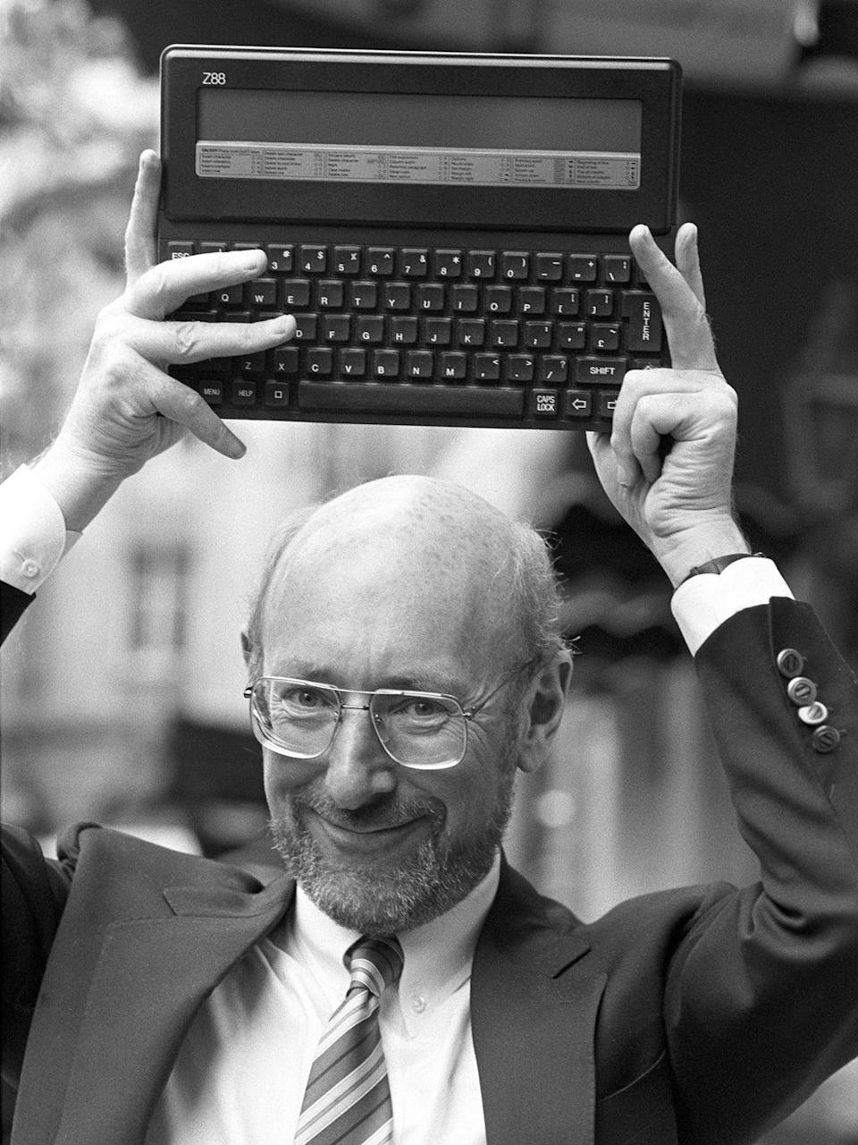 Sir Clive holds up the Z88 in September 1987 (PA)