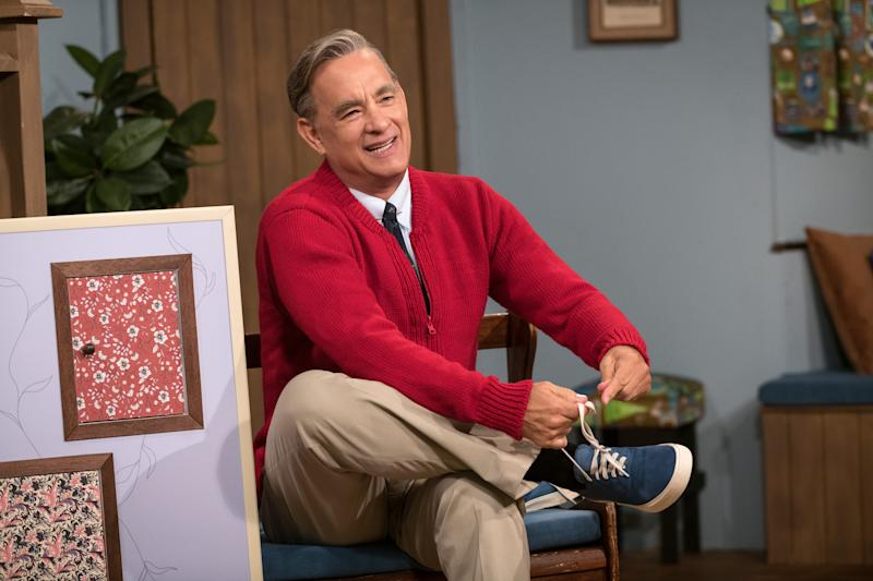 """Tom Hanks dons the red cardigan and comfy sneakers of the iconic Mister Rogers in """"A Beautiful Day in the Neighborhood."""""""