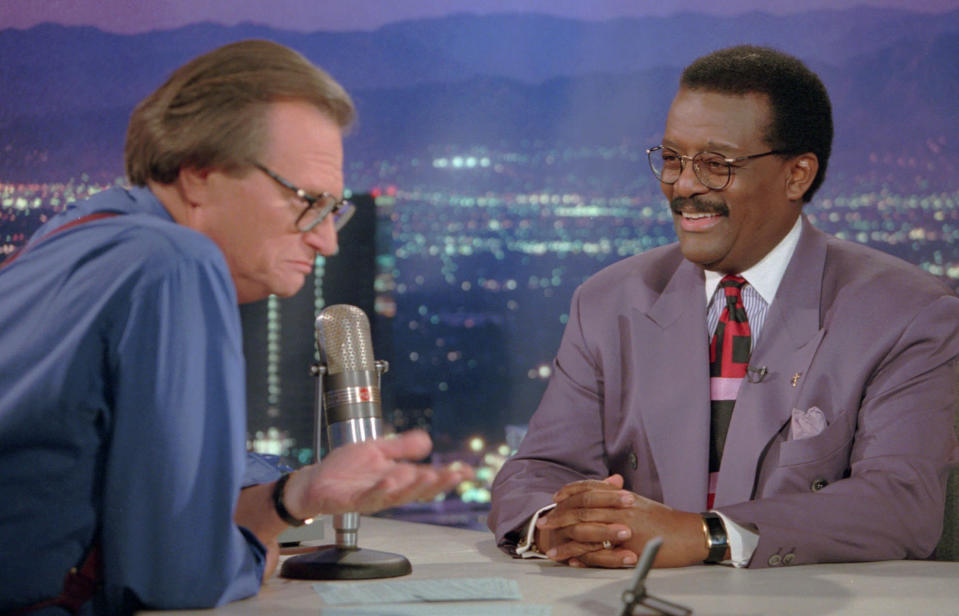 "FILE - In this Oct. 4, 1995 file photo, Defense attorney Johnnie Cochran Jr., right, sits for an interview with Larry King, the host of the ""Larry King Live"" show in the Hollywood section of Los Angeles. King, who interviewed presidents, movie stars and ordinary Joes during a half-century in broadcasting, has died at age 87. Ora Media, the studio and network he co-founded, tweeted that King died Saturday, Jan. 23, 2021 morning at Cedars-Sinai Medical Center in Los Angeles. (AP Photo/Damian Dovarganes, File)"