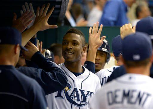 Tampa Bay Rays' B.J. Upton, center, is congratulated in the dugout after hitting a two-run home run during the fifth inning of a baseball game against the Toronto Blue Jays in St. Petersburg, Fla., Saturday, Sept. 22, 2012.(AP Photo/Phelan M. Ebenhack)