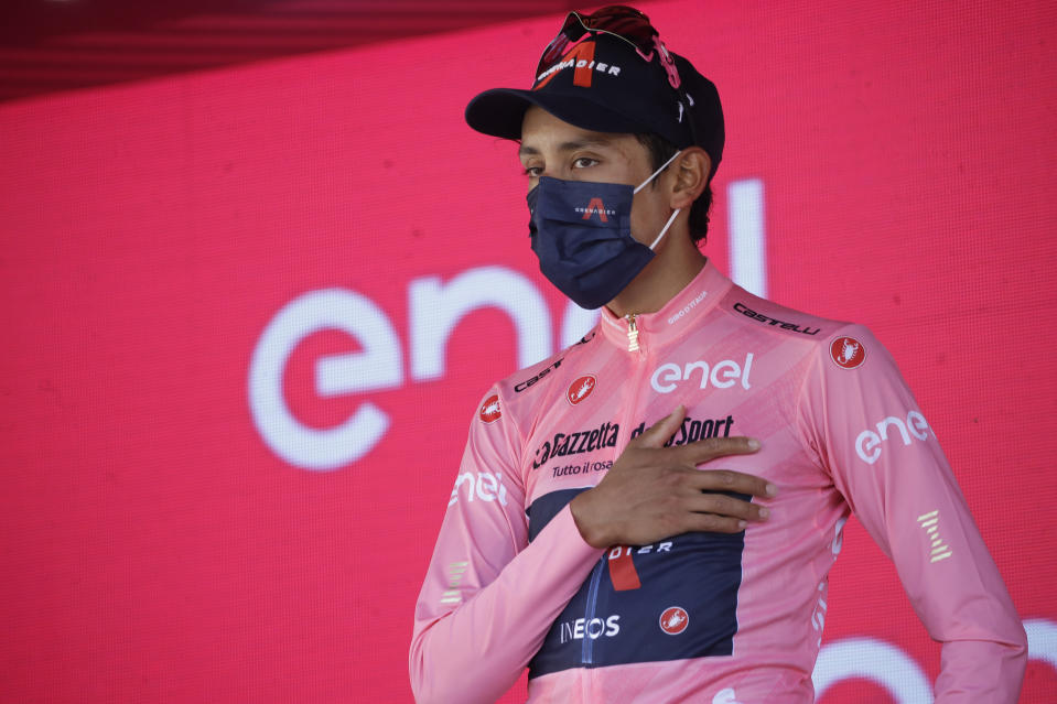 Colombia's Egan Bernal celebrates on podium after completing the final stage to win the Giro d'Italia cycling race, in Milan, Italy, Sunday, May 30, 2021. (AP Photo/Luca Bruno)