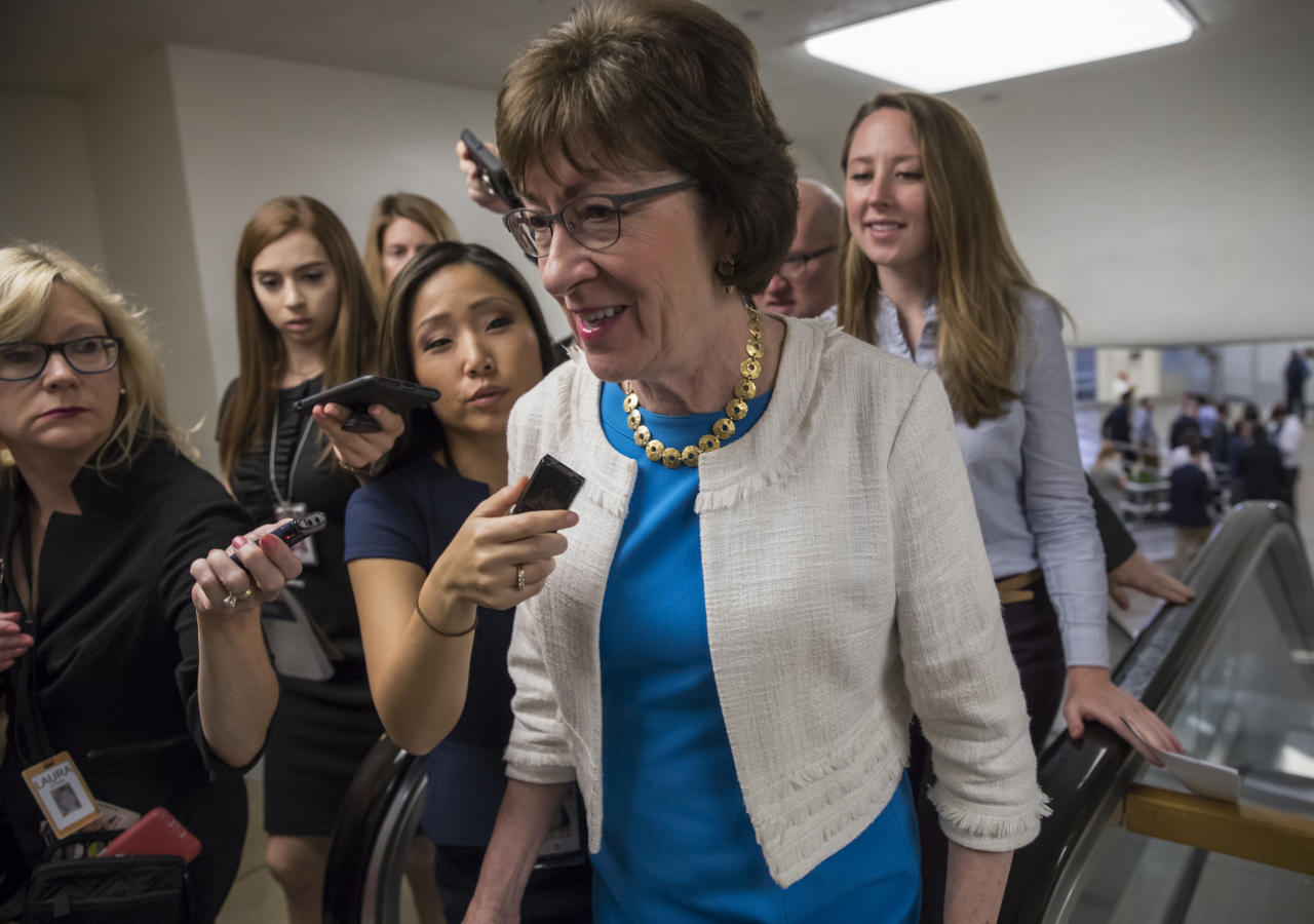 "Sen. Susan Collins, R-Maine is surrounded by reporters as she heads to the Senate on Capitol Hill in Washington, Thursday, July 27, 2017, while the Republican majority in Congress remains stymied by their inability to fulfill their political promise to repeal and replace ""Obamacare"" because of opposition and wavering within the GOP ranks. (AP Photo/J. Scott Applewhite)"