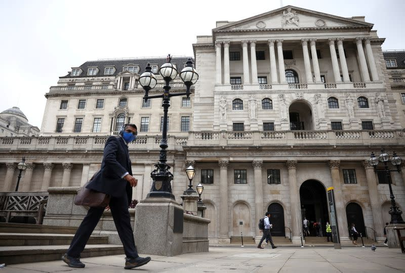 FILE PHOTO: A person walks past the Bank of England in the City of London financial district