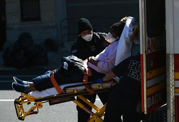 Paramedics carry a stretcher with a patient at Brooklyn Hospital Center -- New York state has about half of the novel coronavirus cases in the United States (AFP Photo/Angela Weiss)
