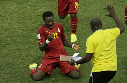 Sulley Muntari celebrates after his team scored against Germany on Saturday. (AP)