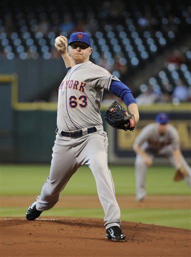 New York Mets' Chris Schwinden delivers a pitch against the Houston Astros in the first inning of a baseball game, Wednesday, May 2, 2012, in Houston. (AP Photo/Pat Sullivan)