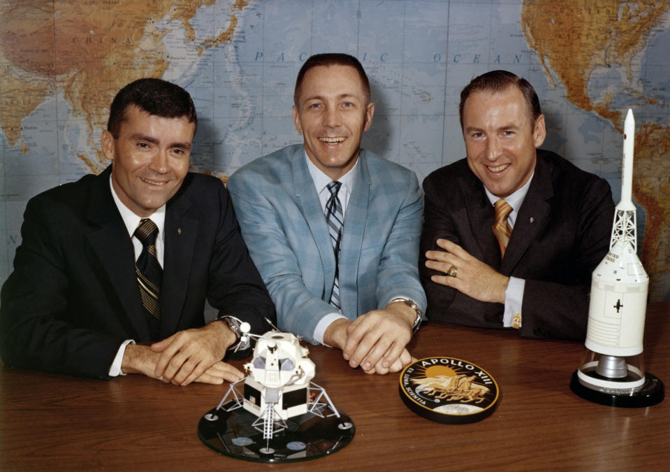 In this April 10, 1970 photo made available by NASA, Apollo 13 astronauts, from left, Fred Haise, Jack Swigert and Jim Lovell gather for a photo on the day before launch. (NASA via AP)