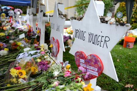 FILE PHOTO: Flowers and other items have been left as memorials outside the Tree of Life synagogue following last Saturday's shooting in Pittsburgh, Pennsylvania, U.S., November 3, 2018.  REUTERS/Alan Freed/File Photo