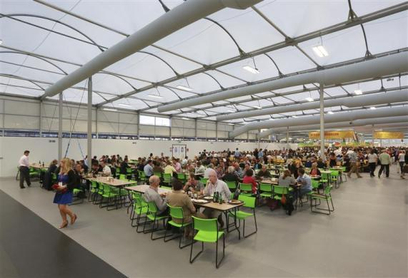 Guests test the 5,000 capacity Olympic Village dining room, a temporary structure built for the London 2012 Olympic Games in Stratford, east London on June 29, 2012.