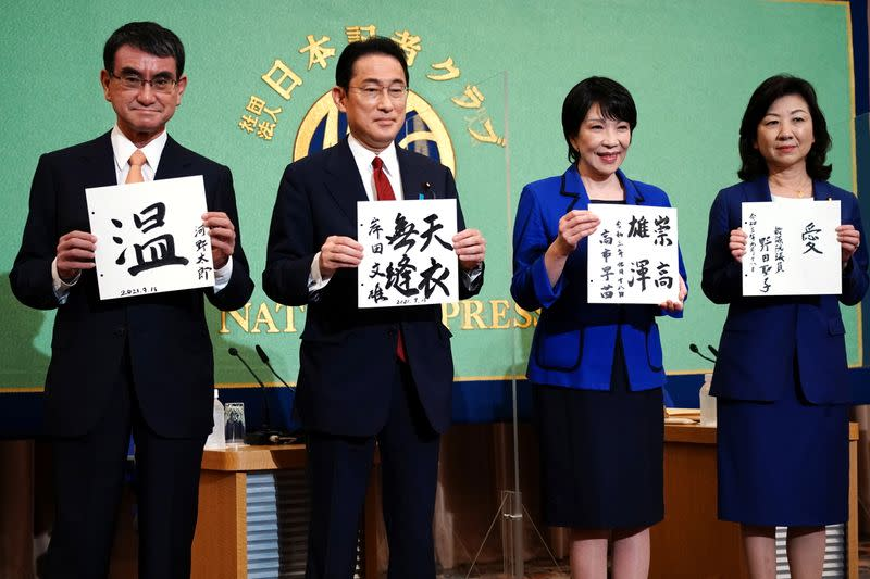 Candidates for the presidential election of the ruling Liberal Democratic Party pose with papers with their sign and words prior to a debate session held by Japan National Press Club