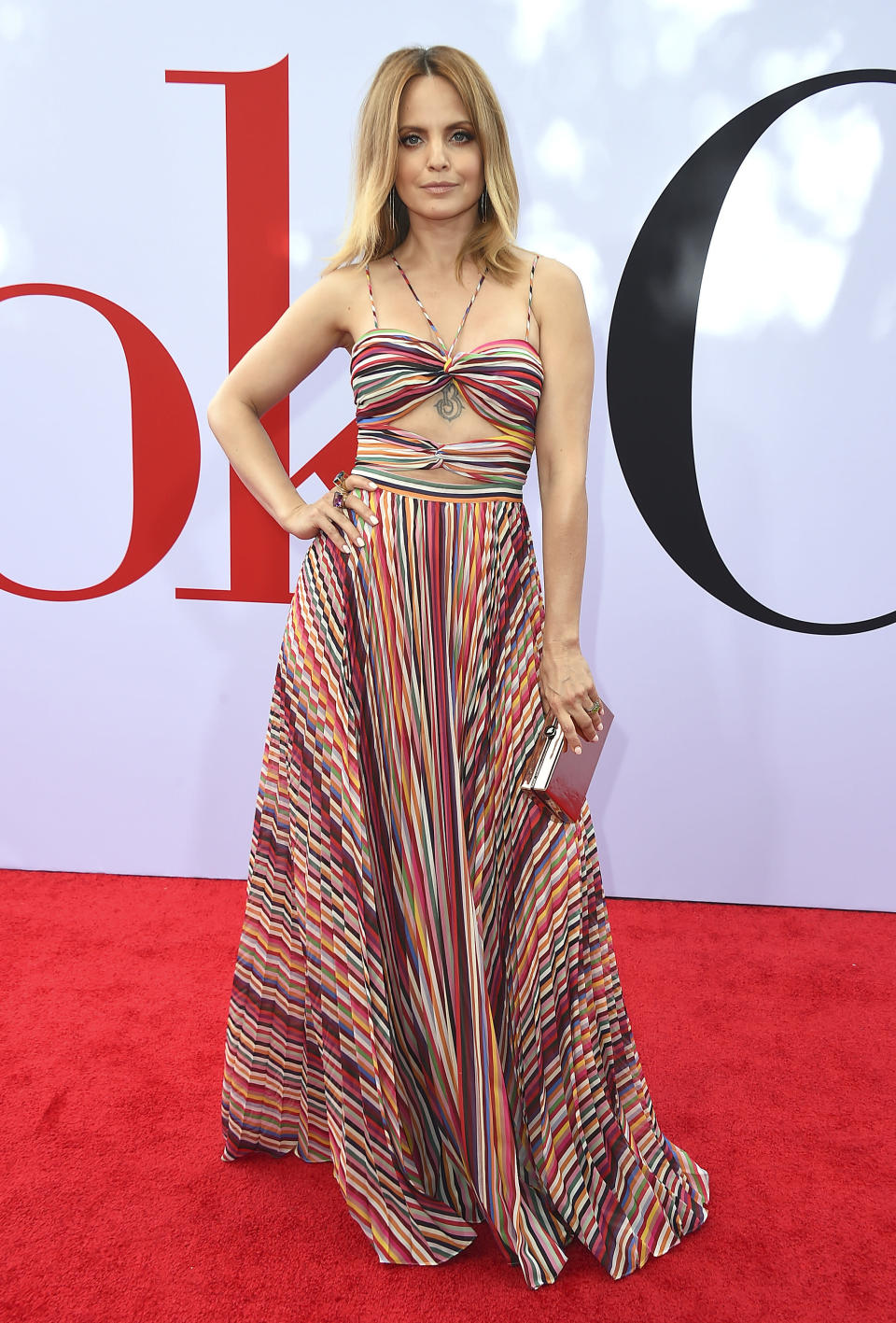"""FILE - Cast member Mena Suvari arrives at the Los Angeles premiere of """"Book Club"""" on May 6, 2018. (Photo by Jordan Strauss/Invision/AP, File)"""