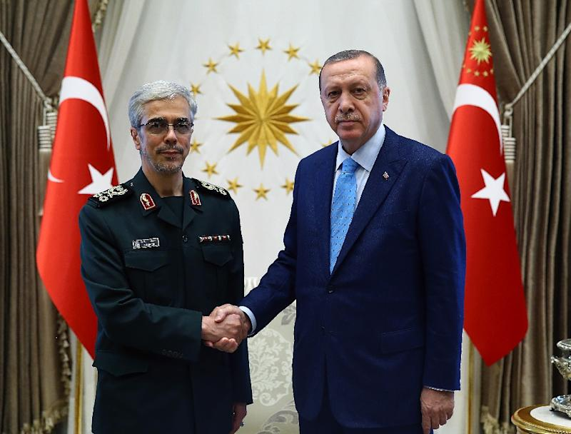 Iranian armed forces chief of staff General Mohammad Hossein Bagheri with Turkey's President Recep Tayyip Erdogan in Ankara on August 16, 2017
