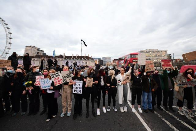 Demonstrators during a protest on Westminster Bridge, central London (Ian West/PA)