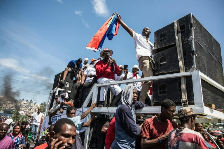 Demonstrators take part in a protest demanding the resignation of President Jovenel Moise in the Haitian capital in Port-au-Prince on October 20, 2019