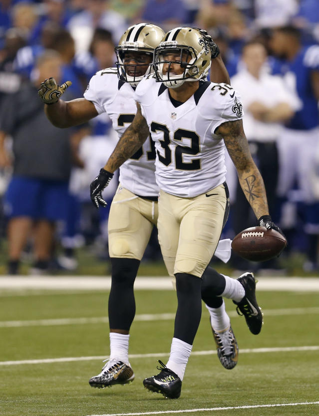 New Orleans Saints strong safety Kenny Vaccaro (32) and cornerback Patrick Robinson celebrate Vaccaro's interception against the Indianapolis Colts during the first half of an NFL preseason football game in Indianapolis, Saturday, Aug. 23, 2014. (AP Photo/Sam Riche)