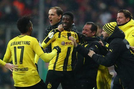 Borussia Dortmund's Ousmane Dembele celebrates scoring their third goal with coach Thomas Tuchel and coaching staff