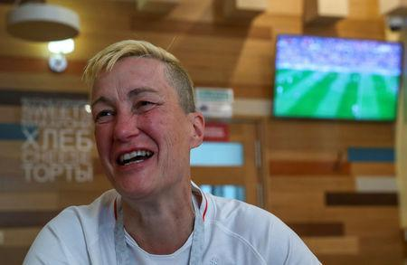 England's fan and LGBT rights campaigner Di Cunningham smiles during an interview with Reuters in Volgograd, Russia, June 18 2018. REUTERS/Sergio Perez