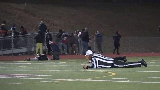 PHOTO: Referees and players take cover after shots were fired at a high school football game in Pleasantville, New Jersey, Nov. 15, 2019. (ABC News)